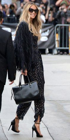 Elle Macpherson in a rad fringe jacket and classy pumps