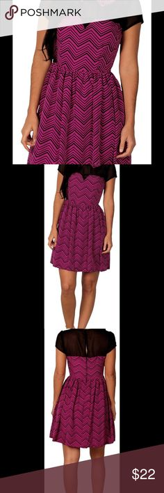 """Junior's Paper Doll Dress Item Information:   Go out in style with this printed illusion dress by Paper Doll. Chic and ultra-feminine, this darling dress is worth raving about. Featuring an on-trend zigzag pattern, a playful Peter Pan collar a flirty, sheer neckline and cap sleeve, it promises to define a stylish ensemble. Zip and button back. 100% Polyester. Machine wash.  Description:  Junior's Printed illusion Dress by Paper Doll          Size 7- Bust 32"""", Waist 26"""", Length 33""""  Material…"""