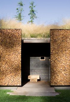 Exterior walls fashioned of stacked wood in steel frames at Stone Creek Camp, located on Flathead Lake in Bigfork, Montana. Designed by Austin, Texas-based Andersson Wise Architects.