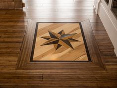 The floor medallion compass, an inlay style chosen by online voters, comprises oak, hickory and teak woods. The compass points true south. Wood Floor Pattern, Wood Floor Design, Laying Wood Floors, Hardwood Floors, Wide Plank Flooring, Cork Flooring, Diy Network, Kitchen Pictures, Teak