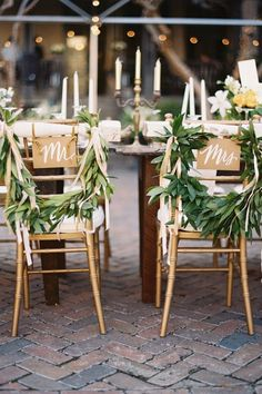 Laurel leaf wreath chair backs with Mr and Mrs calligraphy signage