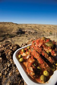 "Pork with Thyme & Olives.   Influenced by Angolan/ Portuguese cuisine.  Learn how to make this masterpiece taken from ""My Hungry Heart: Notes from a Namibian kitchen"" by Antoinette de Chavonnes Vrug here: http://stories.namibiatourism.com.na/blog/?Tag=food+%26+drink"