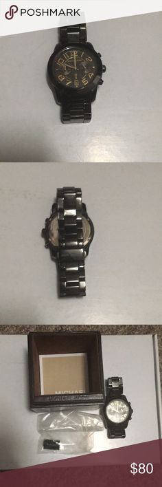 Micaheal Kors black unisex watch Michael Kors black unisex watch. Gold Time. Some wear on the band. Extra links and box are included. Great condition. Price is firm. Michael Kors Accessories Watches