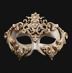 Barroque Dama White Venetian Masquerade Mask - Each hand finished mask might vary in decoration, adornments and style.This is a very unique Venetian mask. It can be worn by a man or a woman as part of a masquerade costume. It's amazing detailing certainly makes it one of a kind. This is a white half-face mask, covering the eyes, nose and cheek area. There is a tremendous amount of intricate detailing around the eyes and cheek and forehead area. #mask #yyc #costume #venetian