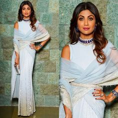 Reception Ready Tarun Tahiliani Shilpa Shetty in a stardust ice blue draped saree from Tarun Tahiliani is proof of why it works! That handcrafted Bharany's choker necklace set with matching sapphire earrings are divine. Saree Wearing Styles, Saree Styles, Dress Styles, Indian Gowns, Indian Sarees, Indian Wear, Indian Attire, Bollywood Saree, Bollywood Fashion
