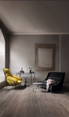 eclectic living room.  yellow chair, velvet couch, modern table.
