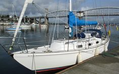 A Kim Holman designed Twister 28 sailboat, alonside the quay at Tamar River Sailing Club, Plymouth, UK