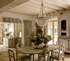 French Country dining - repinned from Christine Ashlaw - reminds me of chairs that I am purchasing & dining chandelier I saw at Vintage Home