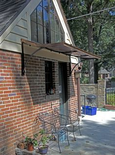 This custom #copper #awning provides shelter over the back door of a Tudor Revival home.