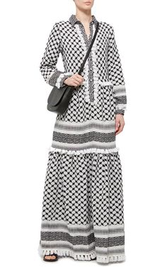 This **DoDo Bar Or** dress is crafted in a midweight cotton with a black and white geometric pattern.