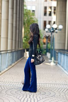 LOVE simple black turtlenecks with anything...shown here with blue velvet  pants and gold accessories.
