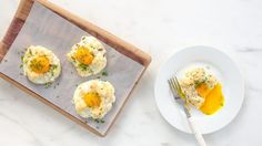 Whipped egg whites make the perfect bed for baked yolks.