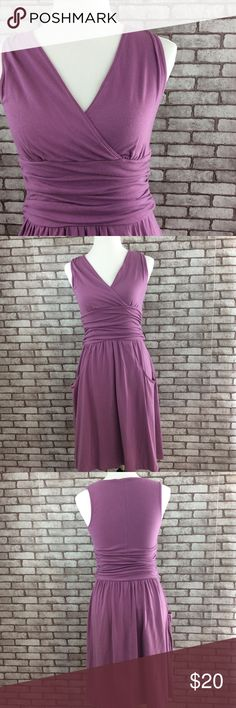 """Athleta Jura dress Very comfy dress!! Gently used, good condition. This is the Jura shirred- waist dress. Nice lightweight breathable dress. Has two pockets. No rips stains or pilling. 56% cotton, 38% modal , 6% spandex, machine wash. 38 1/2"""" long, 15 1/2"""" bust laying flat, 13 1/2"""" waist laying flat, 18 1/2"""" hip laying flat. ⭐️ no trading or modeling ⭐️ Athleta Dresses Midi"""
