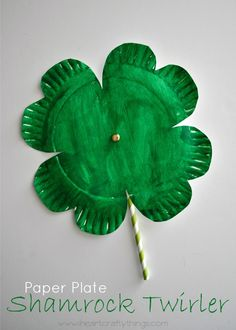 Shamrock Twirler St. Patrick's Day Craft | Spin the shamrock around and watch it twirl. Fun craft for kids. | from iheartcraftythings.com