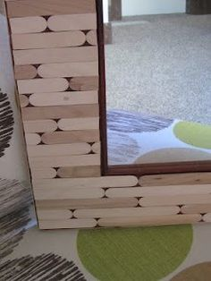 Popsicle Stick Frame for a Photo or Mirror. {I want to do this, but paint each stick with a different bright color and pattern, for a cool Bohemian patchwork effect!}