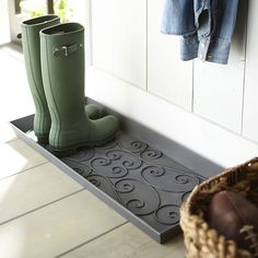 Rest your wet and dirty boots or shoes on our boot tray and help save the floor from clutter and stains. Handsome, with vintage appeal, powder-coated iron tray features scrolling detail. Convenient carry handles help make it easy to move to heavily trafficked areas—inside the door, mud room or garage.