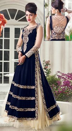 Awesome!!! Amazingly crafted dark blue and off white designer salwar kameez on velvet and net material is beautified with resham, embroidery and stone work. This suit comes with contrast bottom and dupatta. Two options pick one and get one. This Salwar Kameez can be stitched in the maximum bust size of 42 inches.