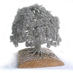 Artist Clive Maddison tightly winds wire to create beautiful tree sculptures without adhesives. #art #sculpture #nature