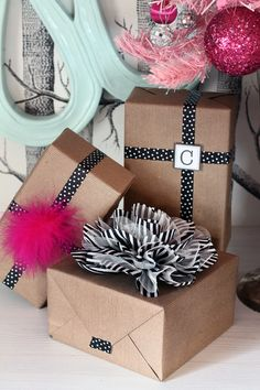 Wrap Packages in simple Craft Paper & use patterned Washi Tape instead of ribbon.