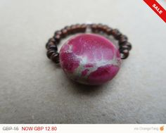 Check out this item in my Etsy shop https://www.etsy.com/listing/198945920/sale-pink-gemstone-bead-ring-jasper