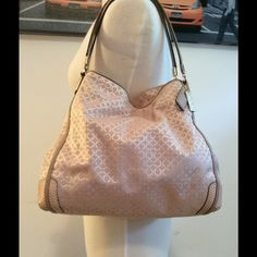 """Authentic Coach Signature C Champagne purse.  Authentic with serial number Coach large bag, Champagne signature C fabric, champagne python leather, beige and super clean inside, genuine beige leather straps, gold metals. Great condition, never worn, no flaws. 12"""" X 14"""" X 6"""" Large bag  No trades. No holds. No more discounts for this bag, It is not easy to find good prices for reselling, do not ask for lower prices please.  Click the listings to see the boutique ;-)  Thanks for your visit ;-)…"""