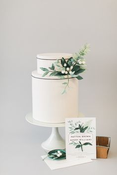 Green and gray simple yet elegant wedding cake design by Nine Cakes. Photography by Judy Pak. Wedding Invitation by Shiny Penny Studio.