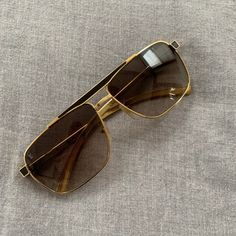 60748425765 LV Goldtone Frame Persuasion Carre Sunglasses LV Goldtone Frame Persuasion  Carre Sunglasses These Louis Vuitton Persuasion