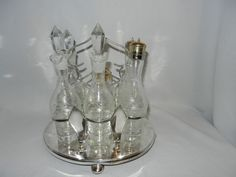 Vintage Robert Pringle and Sons Oval 6 Intaglio Bottle Cruet Set from mygrandmotherhadone on Ruby Lane