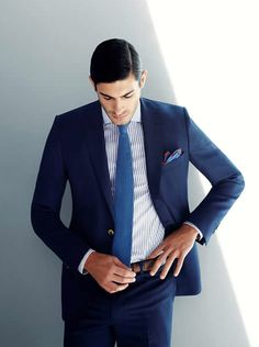 This is a way to rock a suit! Slim fit shoulders, tapered jacket sleeves, great sleeve length, and light brown (not black) accessories. The tie also nicely bridges the gap between suit and shirt, and the pocket square is fun and playful without looking casual.