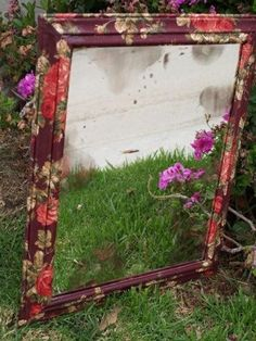 fabric mod podge mirror idea..  have a mirror just like this in the bathroom.. would look really cool