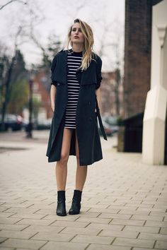 {Street style} | Black coat, striped teeshirt dress, black ankle boots.