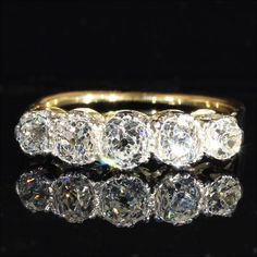 Edwardian 5 Stone Diamond Ring in 18k and Platinum, c. 1910 from vsterling on Ruby Lane