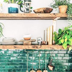 @justinablakeney's kitchen is definitely a looker  We love the use of open shelving here as it allows for house plants and dish ware to be displayed!