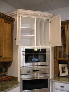 Like the shelves above the oven. The idea of two toned...maybe the same color as the island?