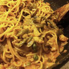 My own version of creamy pasta primavera. Spaghetti noodles with cauliflower, portabella mushrooms and sugar snap peas.