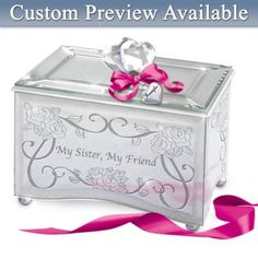 Remind your sister how much she means to you when you give her this mirrored music box engraved with her name.