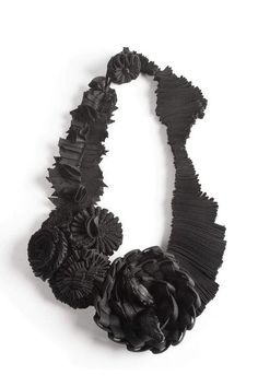 Textiles Jewellery - fabric flower necklace made using a variety of folding techniques - fabric manipulation; contemporary fabric jewelry // Marina Callis