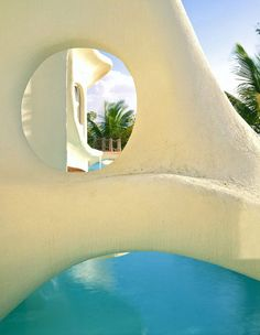 Sculptural, modern stucco home - Architectural Digest - photo by Ron Blunt
