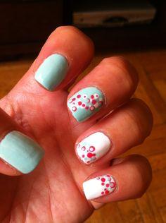 Nail art with fresh mint, bright white, juicy melon dots.