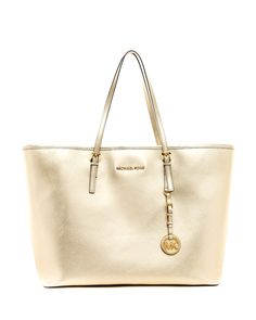 628635c38f91 Michael Kors Gold Jet Set Medium Travel tote Used. In great condition  except the handle has some flaws Michael Kors Bags Totes