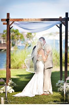 Love the lace around the veil and the khaki suit! as well as the the decorations