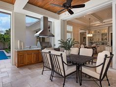 Amazing detail make this outdoor space feel like a continuation of the indoor space at this Moorings home in Naples, FL.