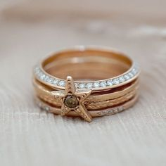 Beachy chic, the Hermosa Stack is ready for summer! This rosy stack features the Twinkling Star ring with a deliciously warm champagne diamond. The mixed textures and sprinkles of diamonds keep this stack twinkling into the twlight. This rose gold ring stack would be perfect for someone who appreciates an understated sparkle. Available to order in 14K yellow, white or rose gold.