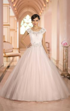 Fit for a princess, this gorgeous Stella York ballgown features a sheer Lace neckline, fitted Lace bodice, and full Tulle skirt. (Style 5923)