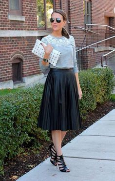 Pleated leather skirt and grey sweater