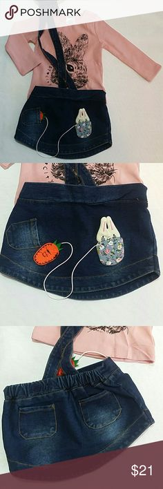 NWOT Denim and Pink Bunny  Skirt Set Adorable two piece set.  Pink long sleeves tee with a cute bunny design and a jeans skirt. The carrot in the skirt come in / out. Very cute item  This item is brand new and never used Dresses