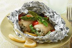 Grilled-Fish Foil Packets Fancy rolled-up fish fillets topped with asparagus and peppers cook up quickly and deliciously wrapped in foil packets with lemons for the grill. Fish In Foil Packets, Foil Packet Dinners, Foil Pack Meals, Foil Dinners, Grilling Recipes, Fish Recipes, Seafood Recipes, Dinner Recipes, Camping Recipes