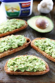 Garlic Bread Avocado Toasts Recipe on twopeasandtheirpod.com Buttery garlic bread with mashed avocado, sea salt, and pepper! This garlic bread is easy to make and SO good!