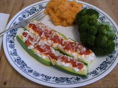 We like to make at least half of our plate fruits and vegetables! Here we have Italian Stuffed Zucchini, mashed sweet potatoes and steamed broccoli! So delicious!
