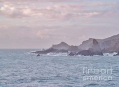 """""""Jagged Edge"""". Sunset approaches at Hartland Quay, N Devon, UK. The sky is clearing after a storm. Spray is whipped up by winds off a choppy sea. A favourite local stretch of coast this shows the treacherous rocks looking north towards Hartland Pt, Blegberry Cliffs, Warren Beach & Damehole Pt. There have been many shipwrecks & legends about this area over the years. Prints available - please click on image to see different sizes and formats available. Photo by & copyright Richard Brookes"""